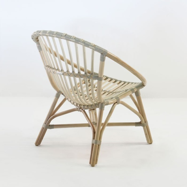 porch indoor arm chair rattan back angle view
