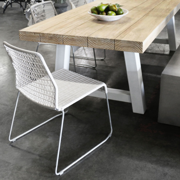 Edge White Wicker Outdoor Dining Chair In Showroom