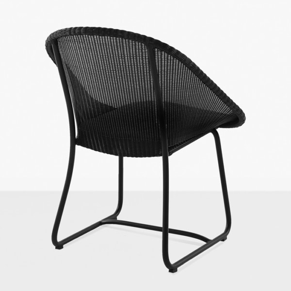 black wicker outdoor dining chair back view