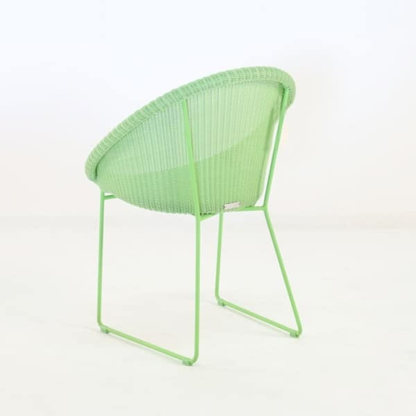 metro outdoor wicker dining chair green back angle view