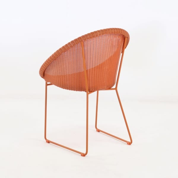 metro outdoor wicker dining chair orange back angle view