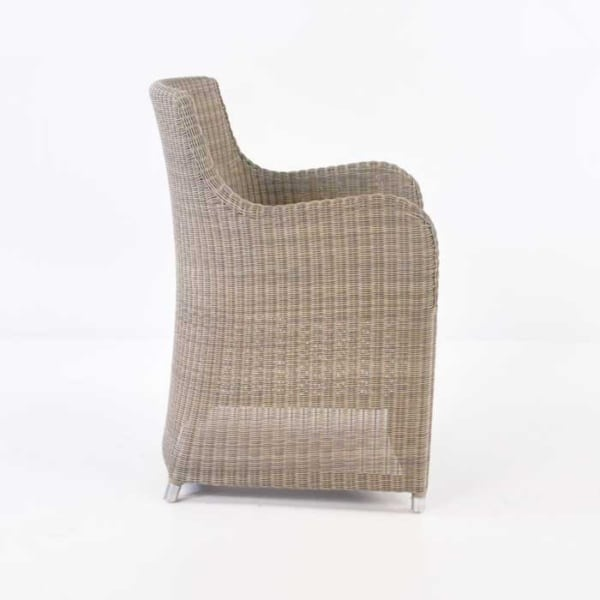 side of moni wicker dining chair in stonewash