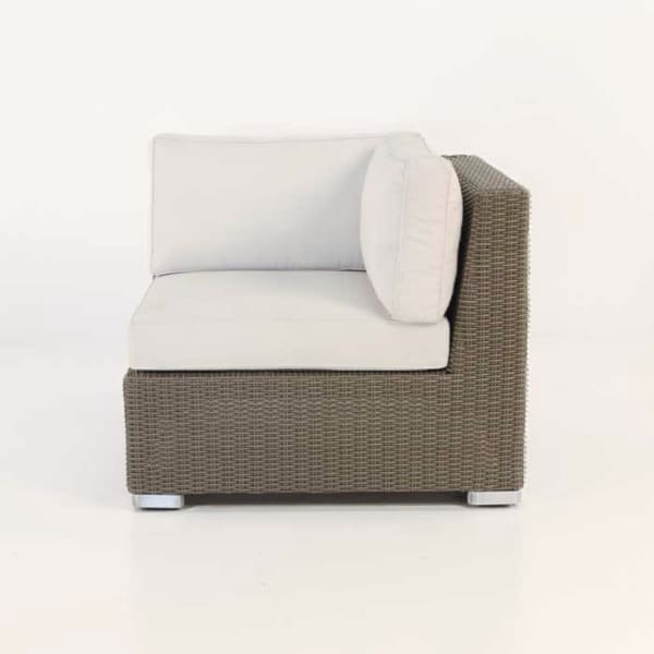 outdoor patio wicker chair with white cushions