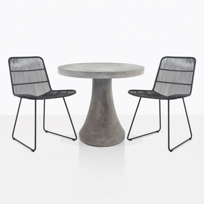 Blok Concrete Round Dining Table With Black Wicker Chairs
