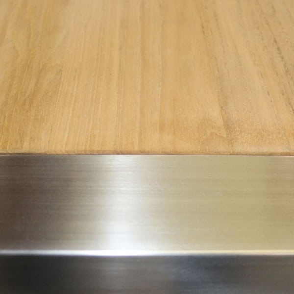 stainless steel and teak plank table closeup view
