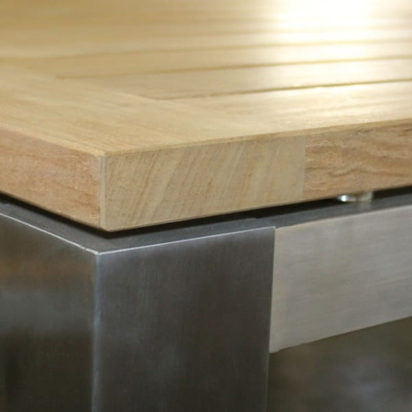 stainless and teak fixed outdoor dining table closeup view
