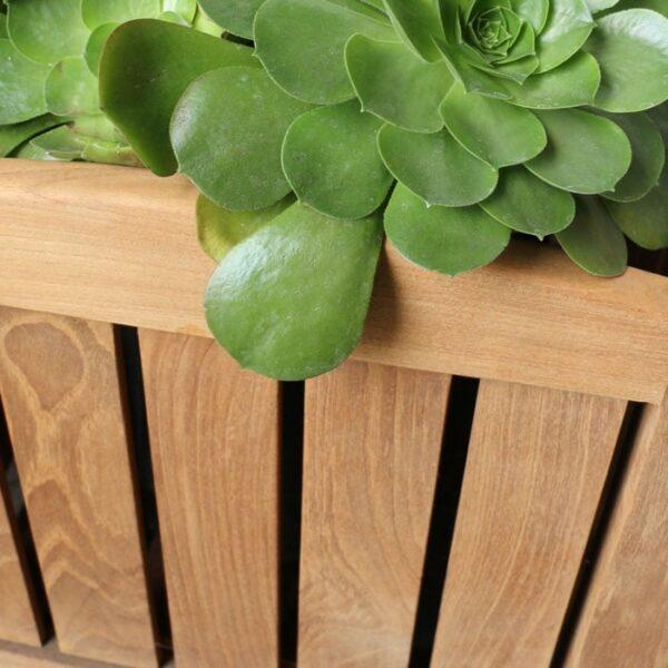 a grade teak planter box with plants