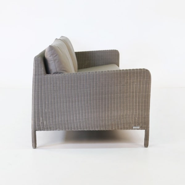 zambezi outdoor wicker sofa side view pebble