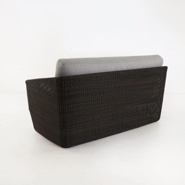 back view of black wicker sofa
