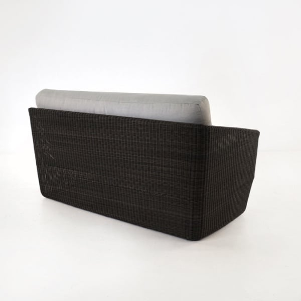 back view of black wicker sofa