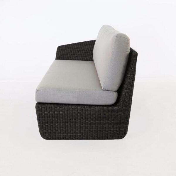 side view of black wicker sofa