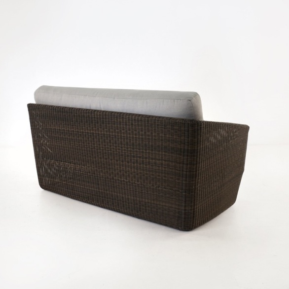brown wicker sofa back view