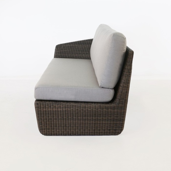 side view of brown wicker sofa