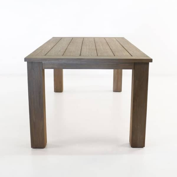 outdoor dining table with four legs made with teak