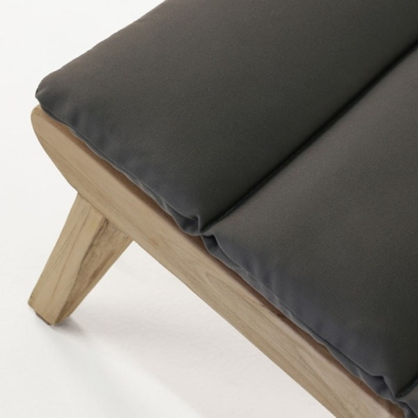 low teak chair with cushion