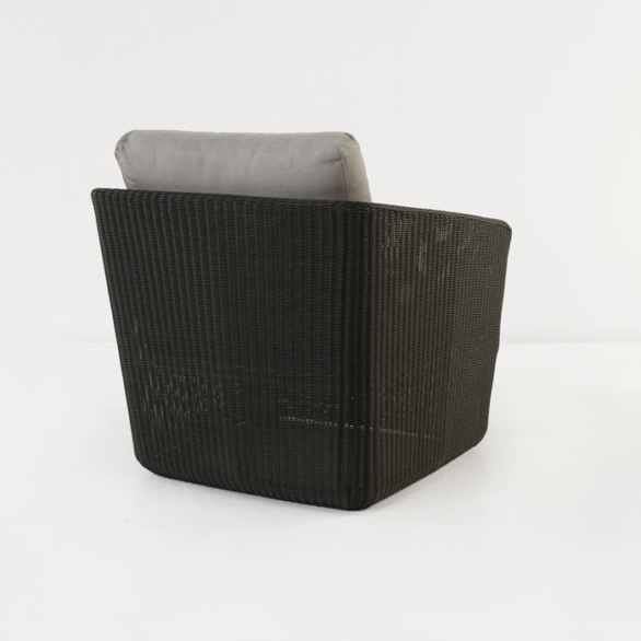 black wicker relaxing chair back view