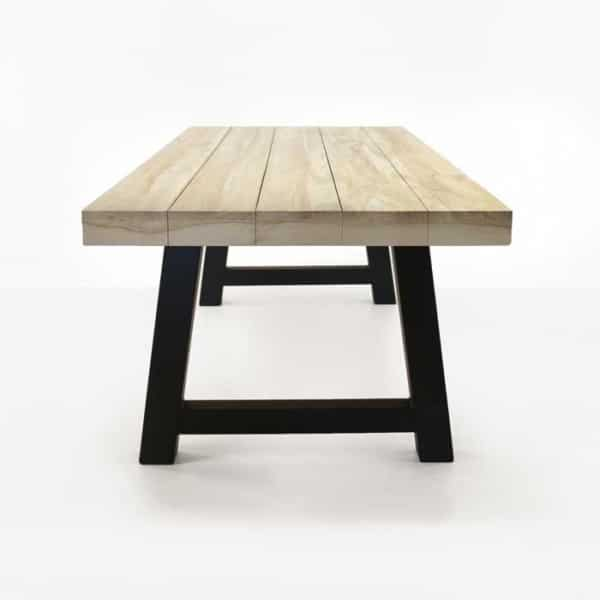 reclaimed teak trestle table with black legs