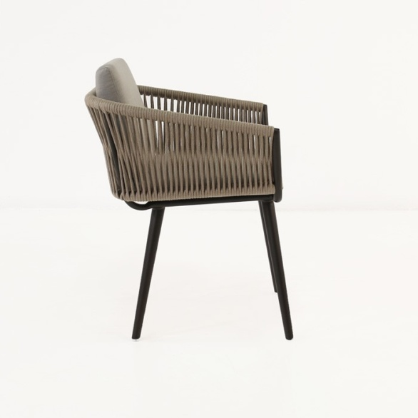 Brown wicker dining chair side view