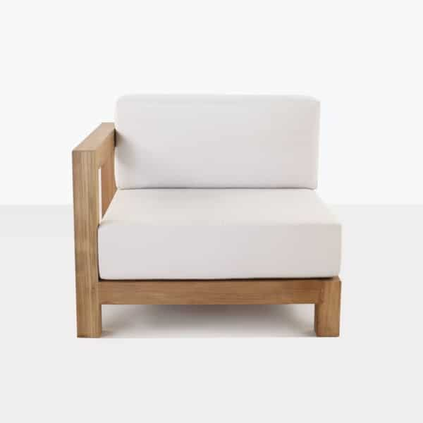 teak right arm chair with white cushions