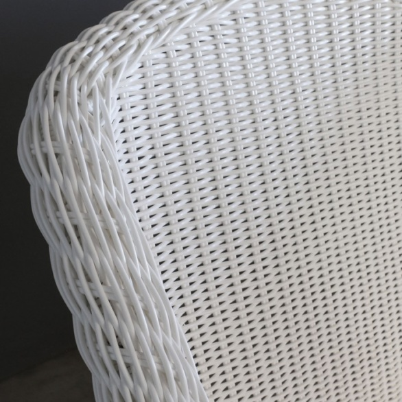 white wicker outdoor dining chair closeup image