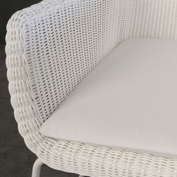 white wicker outdoor arm chair closeup image
