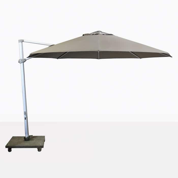 antigua round cantilever umbrella with taupe canopy